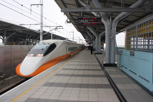 The modern, sleek Taipei HSR bullet train pulls into Chiayi Station.