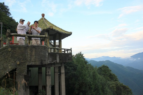 Neal and Henry take photos of the views from Yulao Village at the top of the mountain.