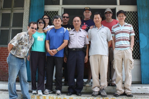 Our entire group poses in front of the Yulao Police Station on our way back to Hsinchu. (From left to right: Tony, Miss Li, Miss Hsu, Mr. Li, Mr. Jien, the local police officer, Gary, Leo Li, Neal, and Henry)